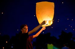 Teen boy  with paper lantern. Teen boy in summer night with paper lantern Royalty Free Stock Photos