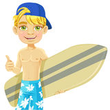 Teen boy with a surfboard isolated on a white back Stock Image