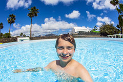 Teen boy swimming in the pool Royalty Free Stock Image