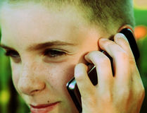 Teen boy talking on cell phone. Teen boy talking on cell a phone Royalty Free Stock Photography