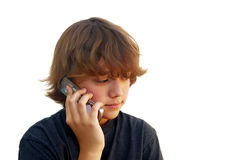 Teen Boy Talking on Mobile Phone. Isolated on white background Royalty Free Stock Photos
