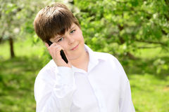 Teen boy talking on  phone outdoors Royalty Free Stock Photo