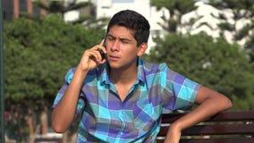 Teen boy talking on phone stock video footage