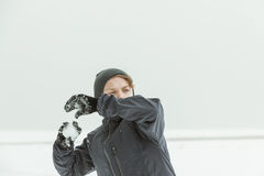 Teen Boy Throwing Snowball Outdoors on Winter Day Royalty Free Stock Photography