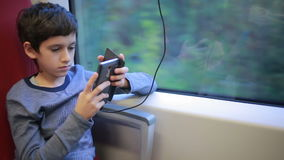 Teen boy traveling on the train stock footage