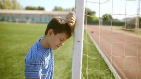 Teen boy upset defeat by knocking goal goal post. Teen boy  upset defeat by knocking goal goal post net stadium turf stock video footage