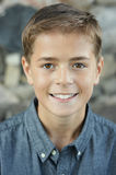 Teen Boy. A very handsome teenaged boy smiling and wearing a gray collared shirt Royalty Free Stock Images