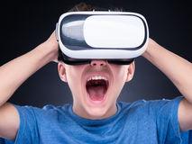 Teen boy in VR glasses Stock Image