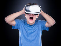 Teen boy in VR glasses Royalty Free Stock Photography