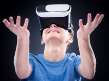 Teen boy in VR glasses Royalty Free Stock Images