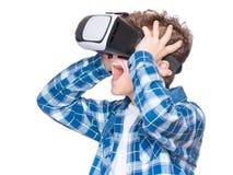 Teen boy in VR glasses Stock Photo