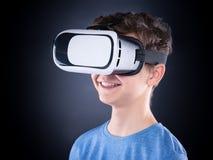 Teen boy in VR glasses Stock Image