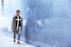 Teen boy walking the tunnel Stock Photo