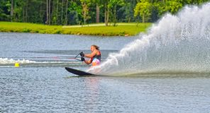 Teen Boy on Water Ski Course. A teenage boy going around a bouy on a water ski course during a competition royalty free stock photo