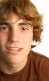 Teen boy wearing braces royalty free stock photos