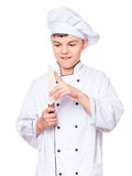 Teen boy wearing chef uniform. Handsome teen boy wearing chef uniform. Portrait of a cute male child cook with big knife, isolated on white background. Food and Royalty Free Stock Photo