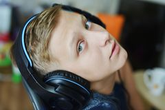 Teen boy wearing headphone. At home playing games Royalty Free Stock Photos