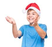 Teen boy wearing Santa Claus hat Stock Photography