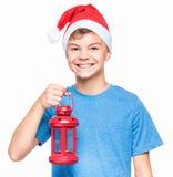 Teen boy wearing Santa Claus hat Royalty Free Stock Image