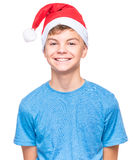 Teen boy wearing Santa Claus hat Royalty Free Stock Photos