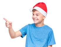 Teen boy wearing Santa Claus hat Royalty Free Stock Images