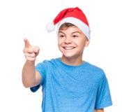 Teen boy wearing Santa Claus hat Royalty Free Stock Photography