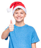 Teen boy wearing Santa Claus hat Stock Photo