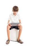 Teen boy holding tablet PC Royalty Free Stock Photo