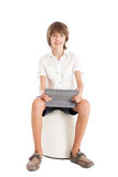 Teen boy holding tablet PC Stock Photo