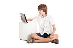 Teen boy with a tablet PC Royalty Free Stock Photo