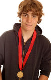 Teen boy wearing winning medal Royalty Free Stock Photography