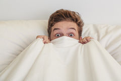 Teen boy in white bed Royalty Free Stock Photography