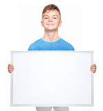 Teen boy with white blank Royalty Free Stock Photo