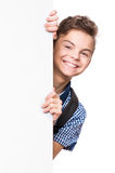 Teen boy with white board Royalty Free Stock Photography