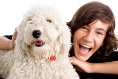 Teen boy with white dog stock images