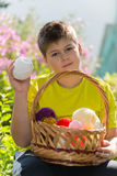 Teen boy with wicker basket and balls of yarn Royalty Free Stock Photos