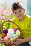 Teen boy with wicker basket and balls of yarn Royalty Free Stock Photo