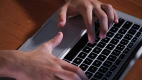 Teen boy working on laptop stock footage