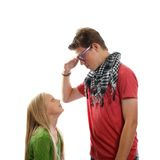 Teen boy and a young girl. A teen boy talking with a young blond girl Royalty Free Stock Images