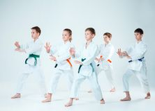 The group of boys and girl fighting at Aikido training in martial arts school. Healthy lifestyle and sports concept stock image
