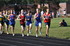 Teen Boys Running in Long Distance Tack Meet Race Stock Photo
