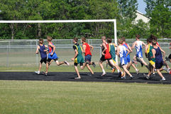 Teen Boys Running in Long Distance Track Meet Race Stock Images