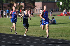 Teen Boys Running in Long Distance Track Meet Race royalty free stock images