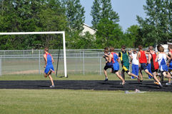 Teen Boys Running in Long Distance Track Meet Race Royalty Free Stock Photography