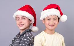 Teen Boys in Santa Hats stock photos