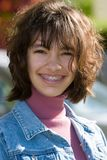 Teen with braces. And wind blown hair taken with narrow depth-of-field and backlight Royalty Free Stock Images