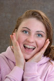 Teen with Braces. Smiling girl showing off her new braces Stock Photo