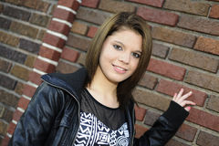 Teen by a Brick Wall Royalty Free Stock Photography