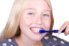Teen brushing teeth Royalty Free Stock Image