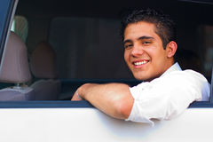 Teen in Car. Teen passenger car backseat looking and smiling Royalty Free Stock Images